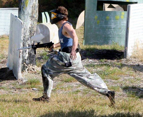paintball player running across field