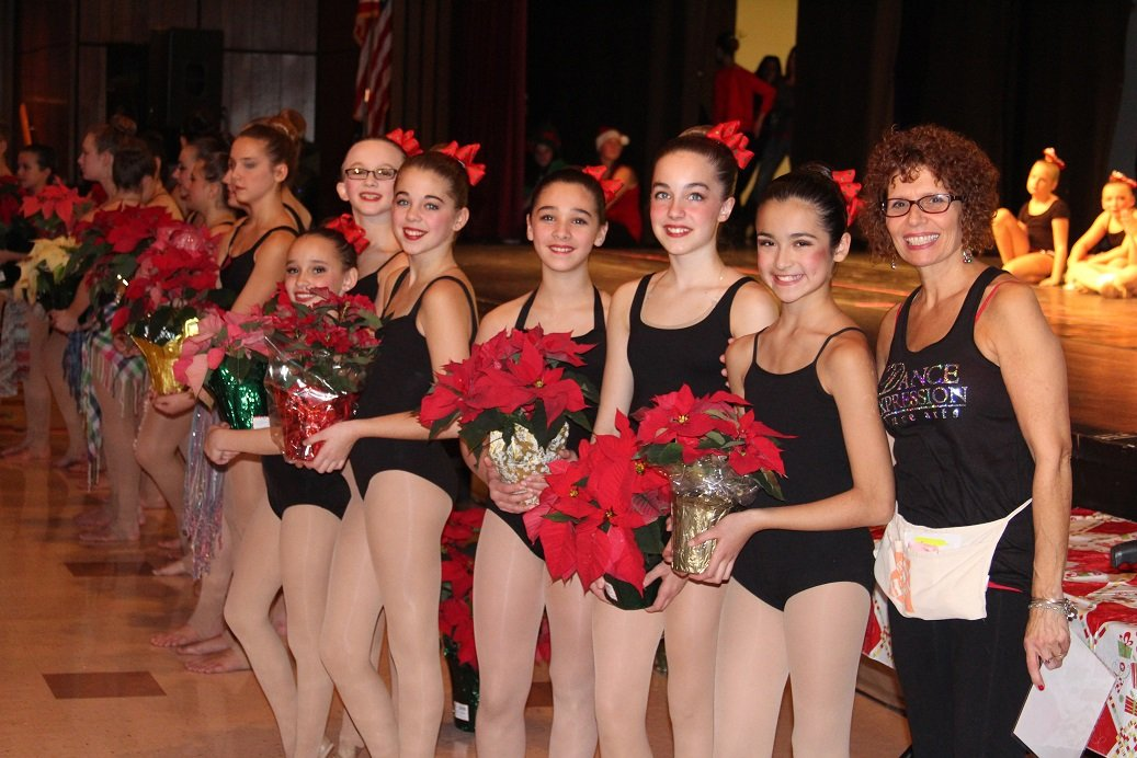 Smiling Dancers with Poinsettas