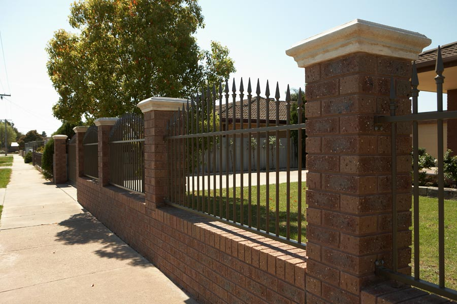 brick and iron fence