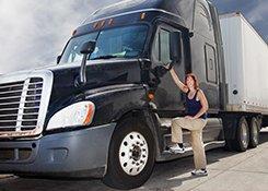 truck driver standing at door of truck