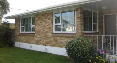 1960s home retaining original wooden & brick cills